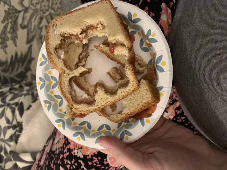 Sandwich crusts on a paper plate