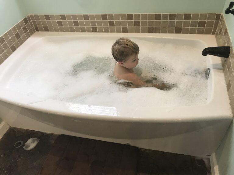 Little boy in bathtub, color photo
