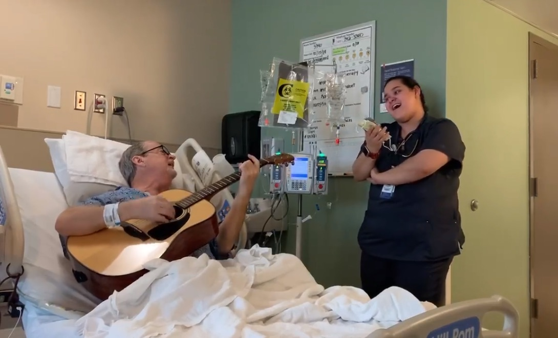 Cancer patient and oncology nurse sing O Holy Night duet