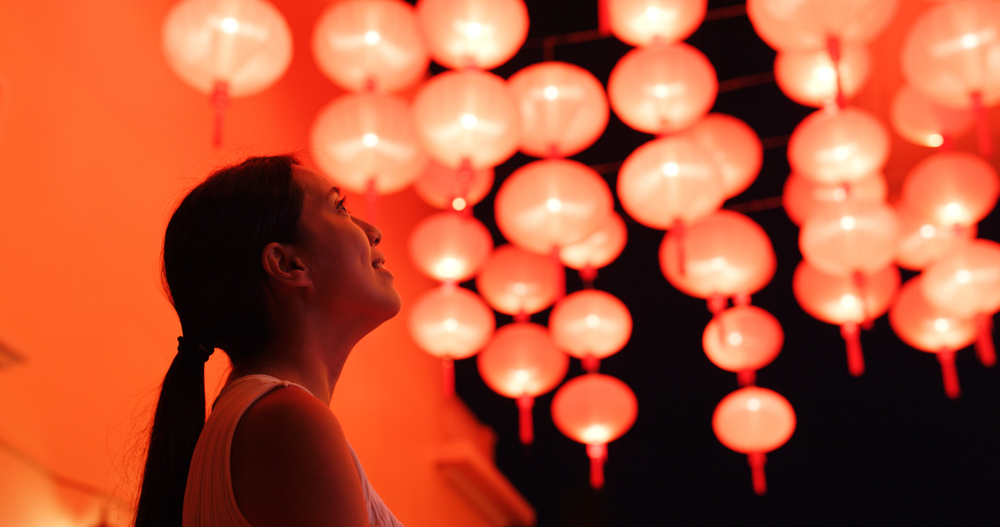 Woman looking at New Year's lanterns