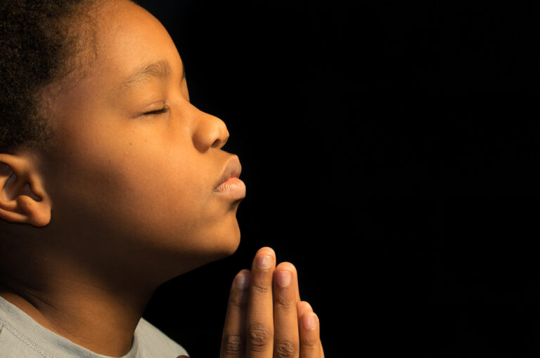 Little boy with eyes closed in prayer