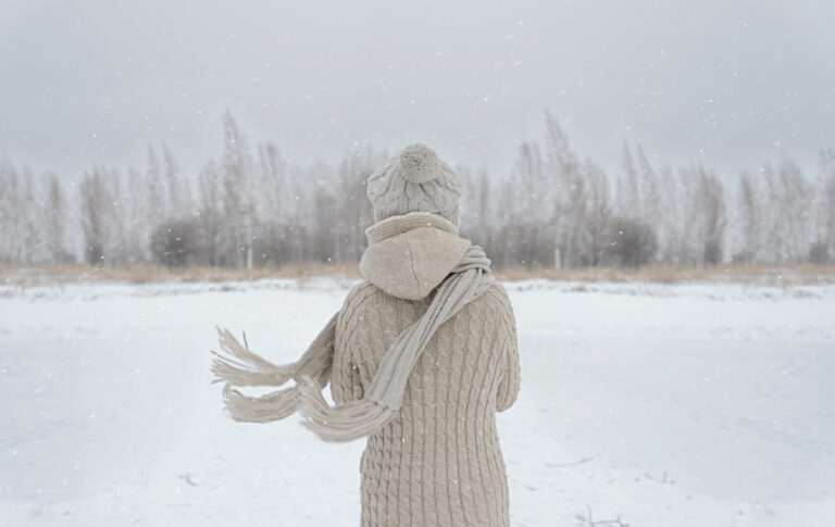 Woman in snow scarf blowing in the wind