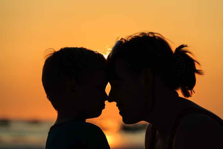 Mother and son touch foreheads silhouette