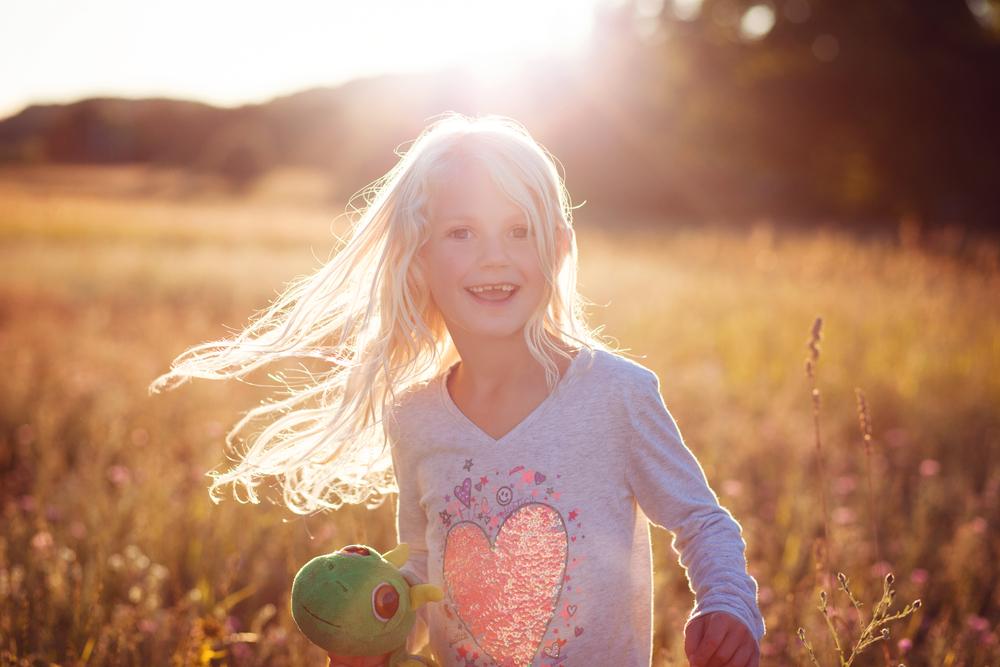 Little girl twirling in sun