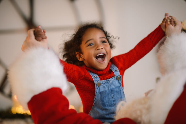 Happy child spinning with Santa Claus