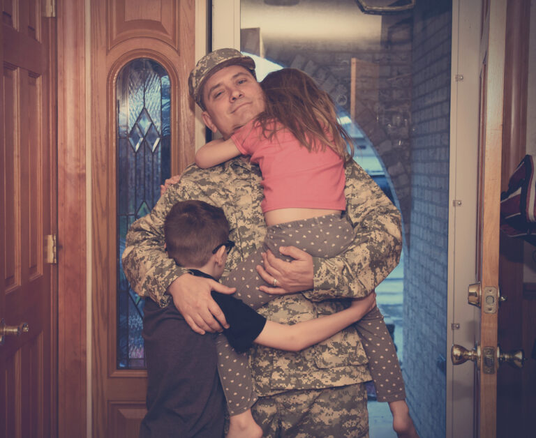 Military father at door with kids