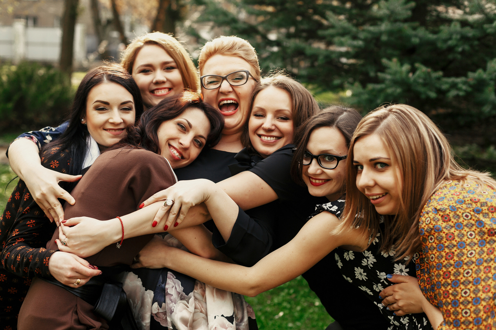 Group of mom friends hugging