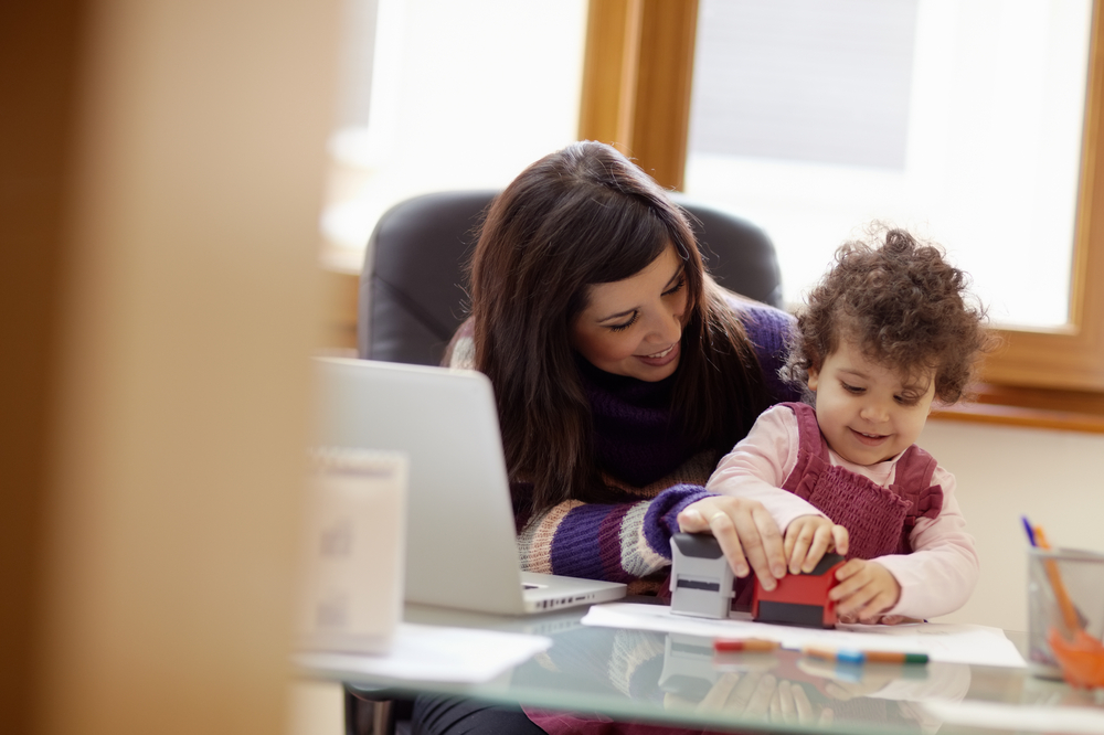 Working mom at desk with child