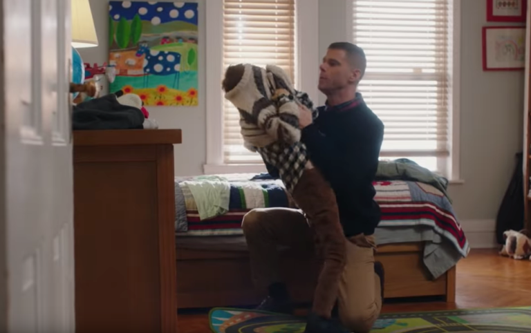 Dad trying to get sweater on child