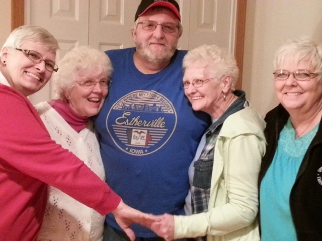 Group of aunts and uncle smiling