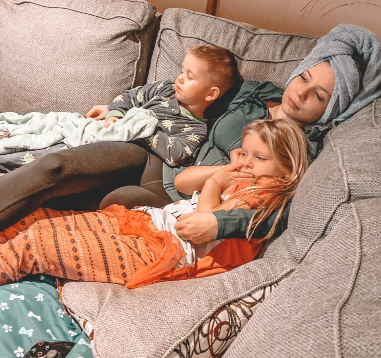 Mother on a couch with two small kids