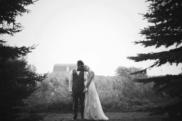Husband and wife on wedding day black and white photo