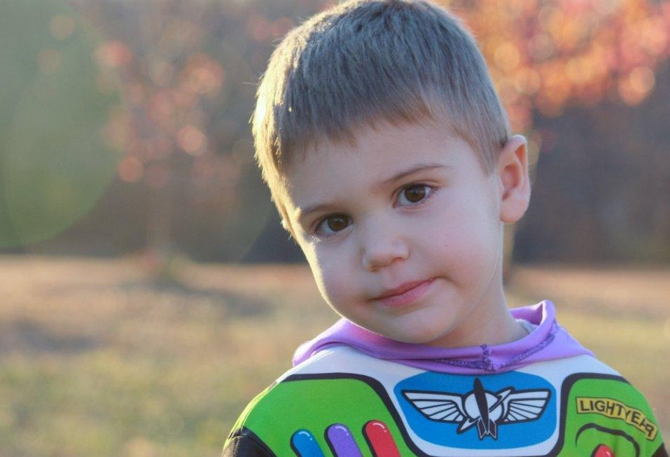 Little boy in Buzz Lightyear costume
