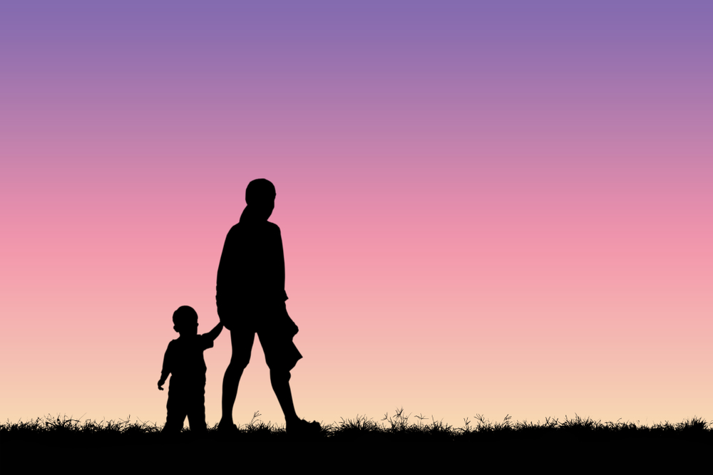 Woman walking with little boy silhouette
