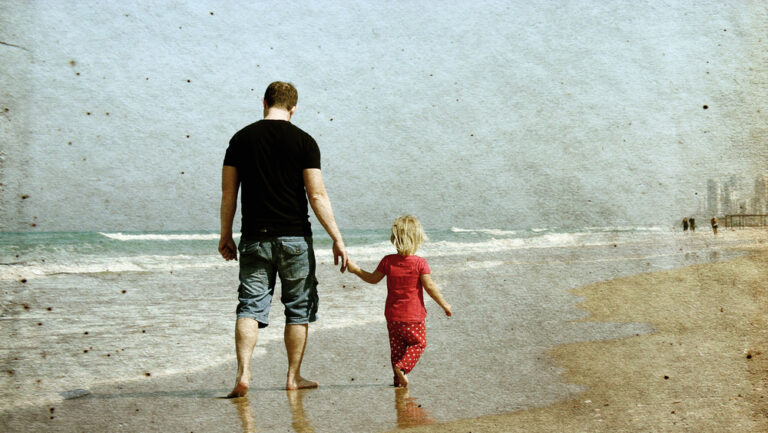 Vintage photo of father and daughter on beach