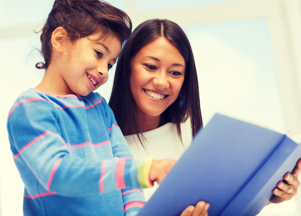 Teacher and child looking at school folder