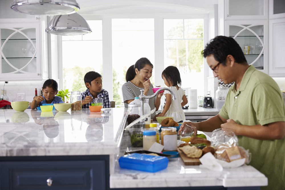 Busy family in the kitchen at home