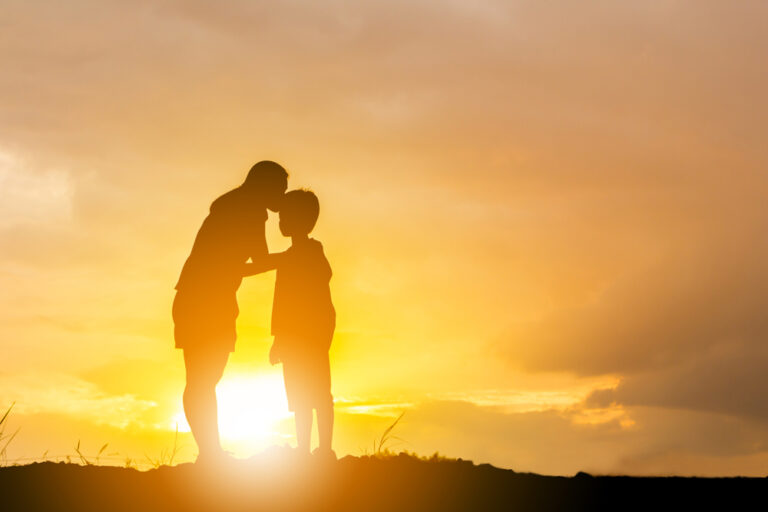 Silhouette of mother and child