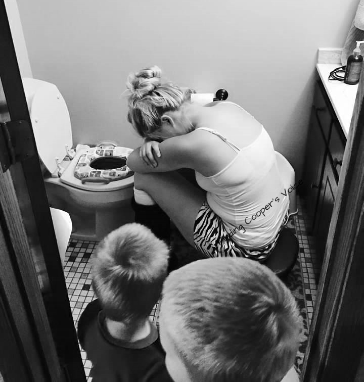 black and white photo of mother crying in bathroom