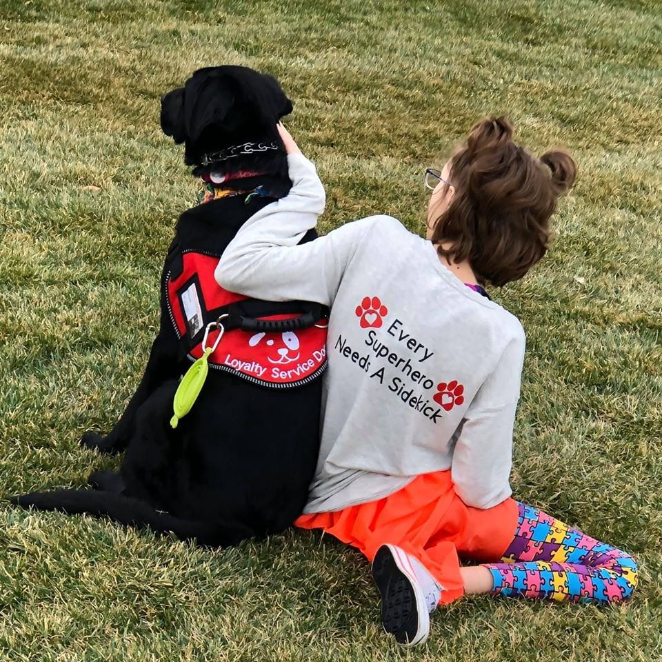 Young girl and service dog