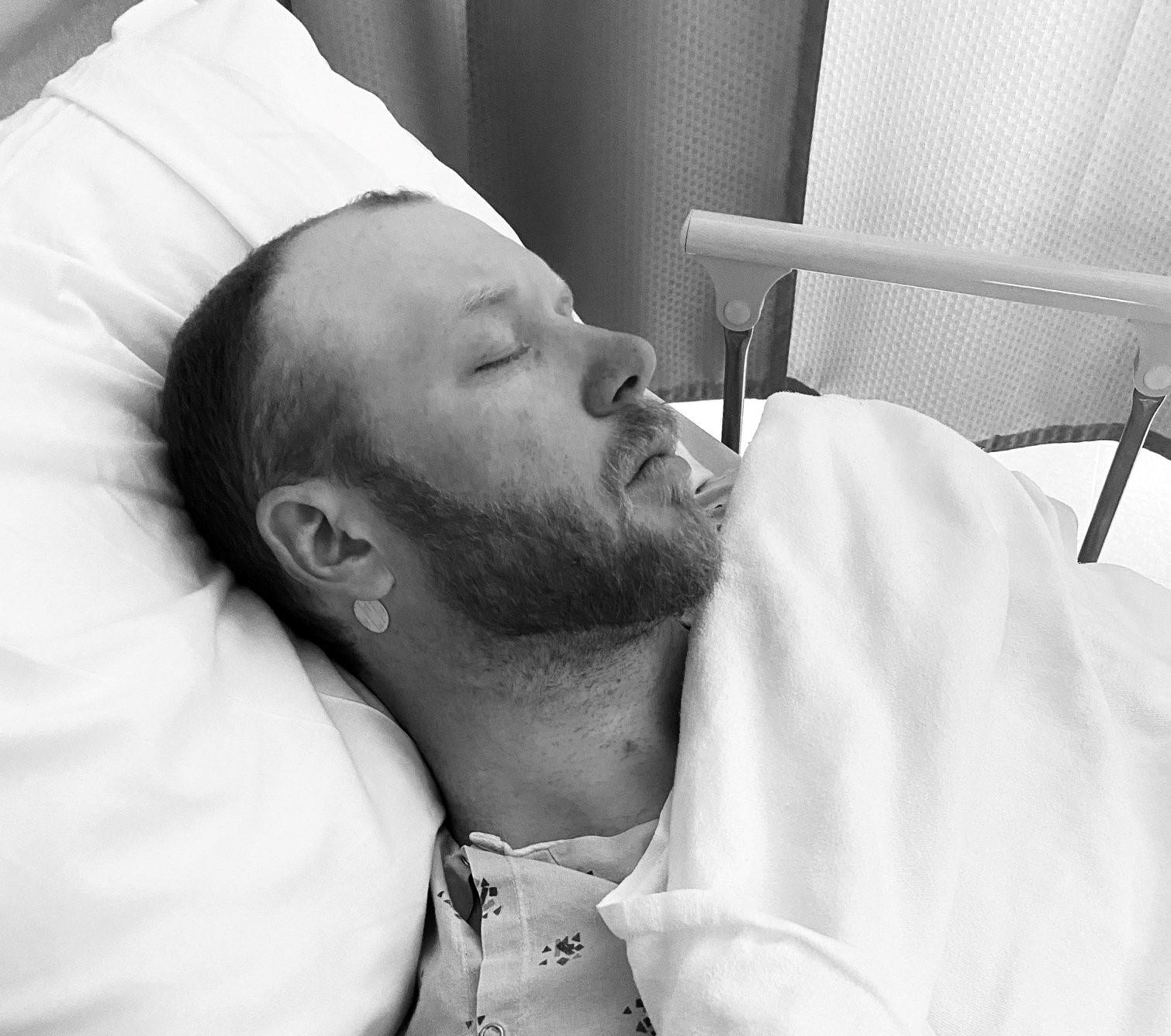 Man in hospital bed sleeping