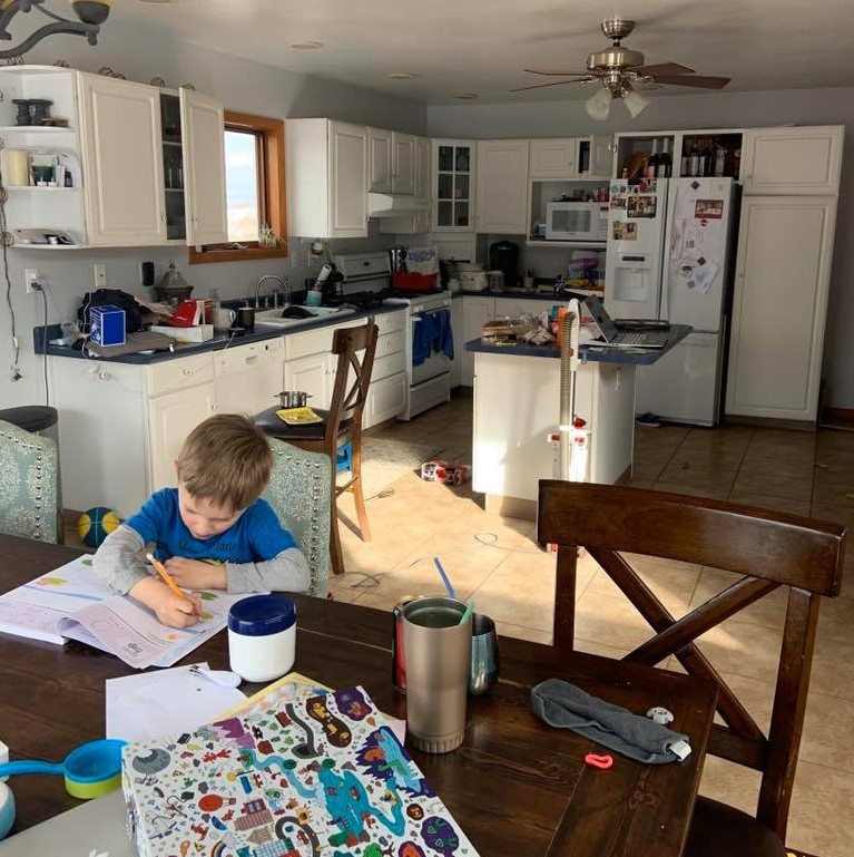 Child sitting at kitchen table