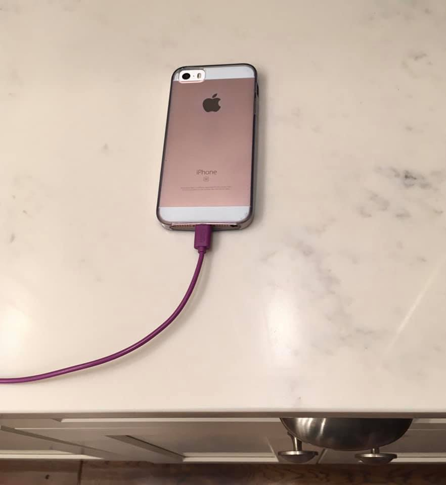 Phone charging on countertop