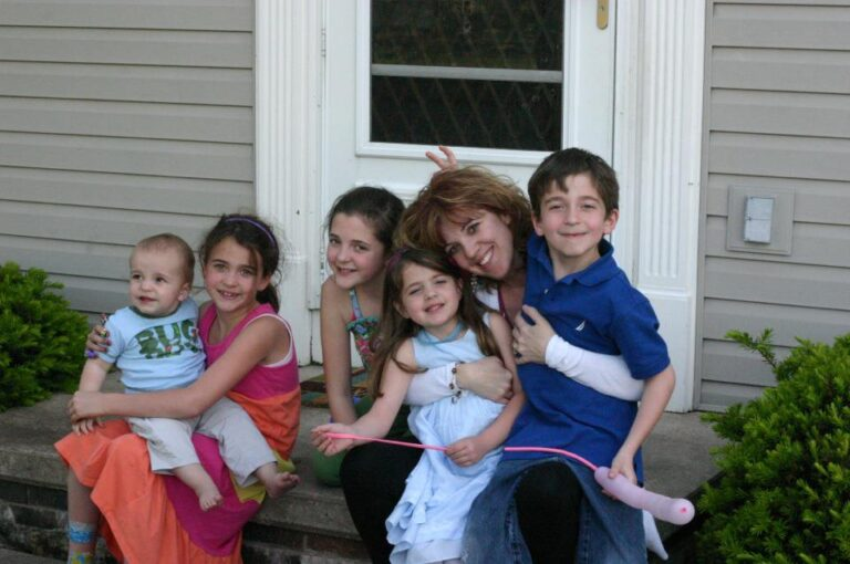 Mom with five kids smiling