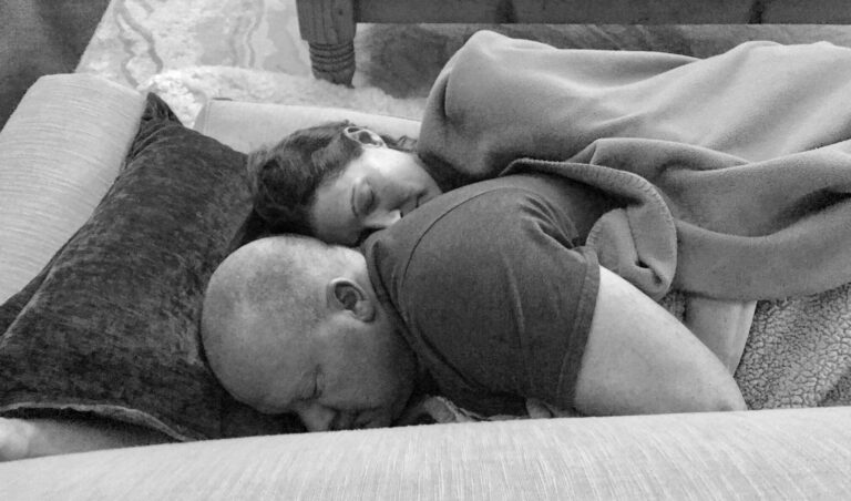 Husband and wife lying next to each other, black-and-white photo