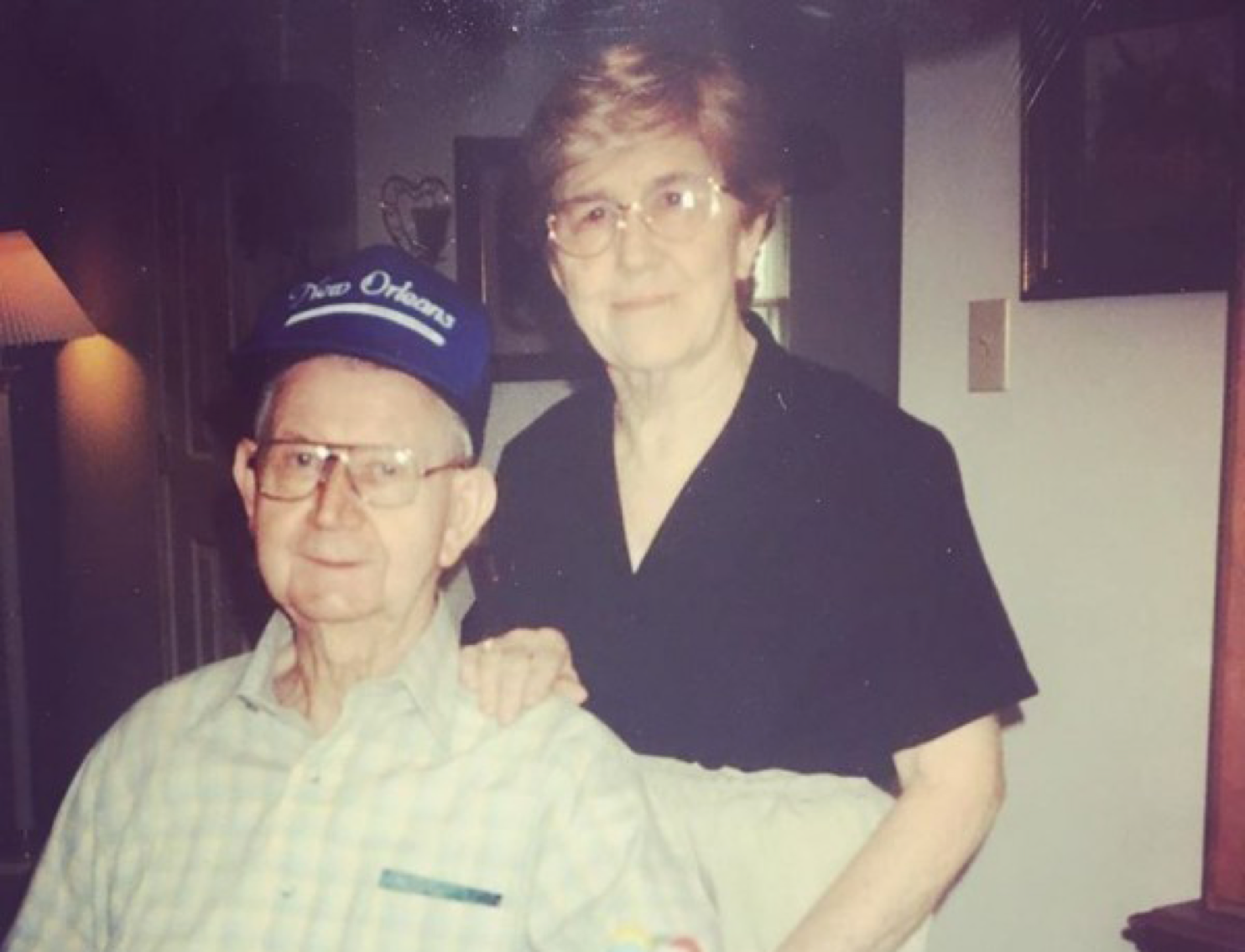 Grandma and Grandpa pose by birthday cake