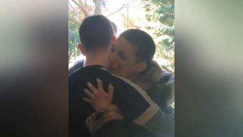 Mom hugging teen boy