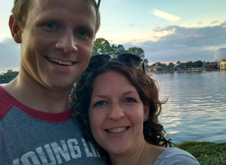 Husband and wife selfie by lake