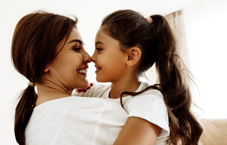 Mother and daughter touch noses