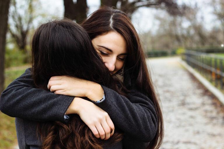 Two best friends hug