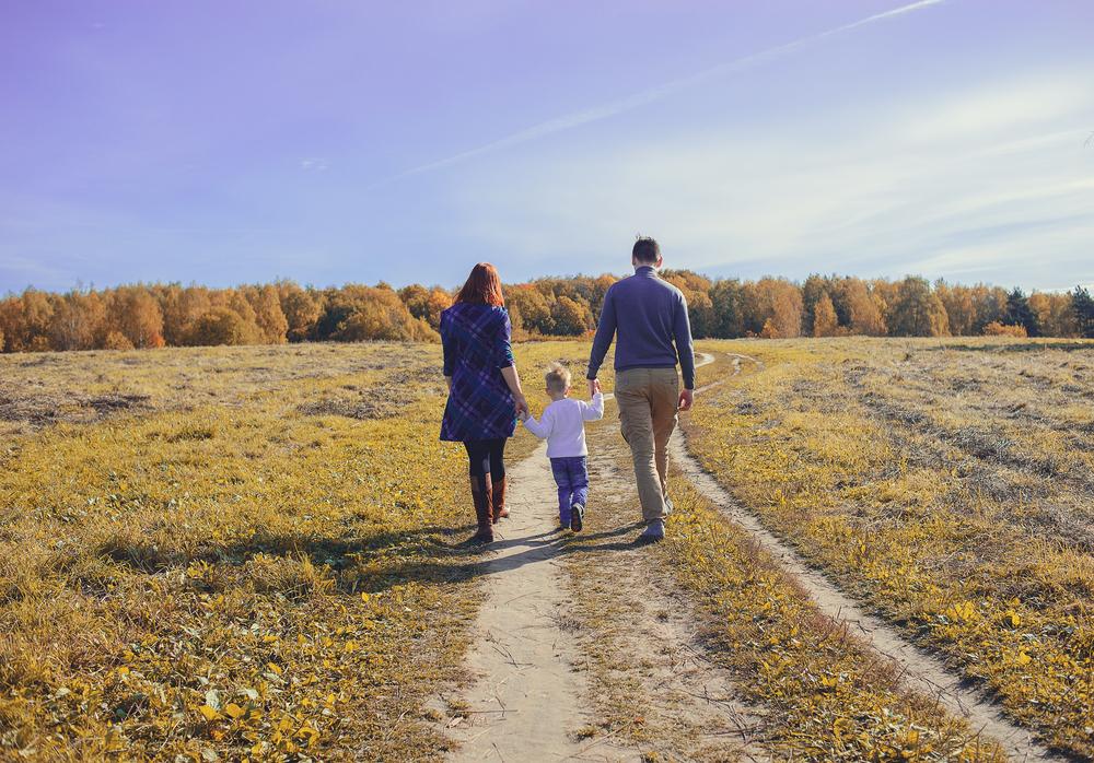 Family walking down dirt road