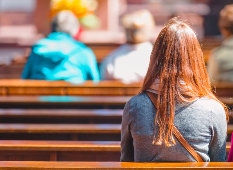 Woman in church pew with long hair