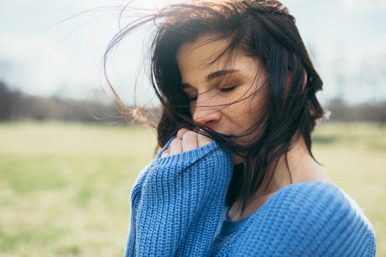 Sad woman wind in her hair