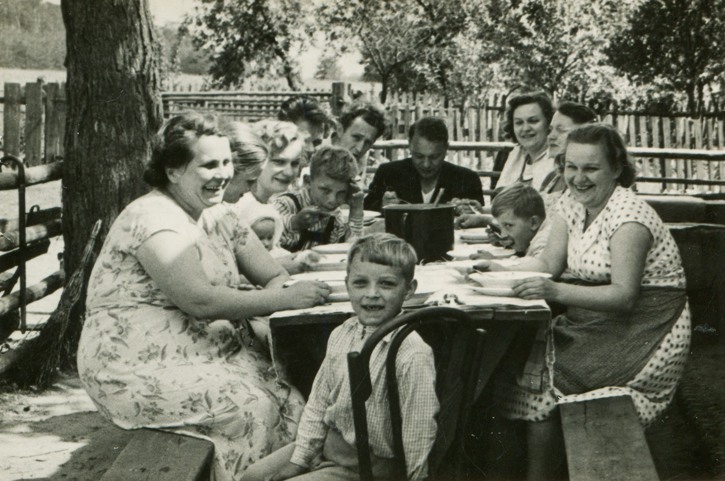 Old family photo, family sitting at table