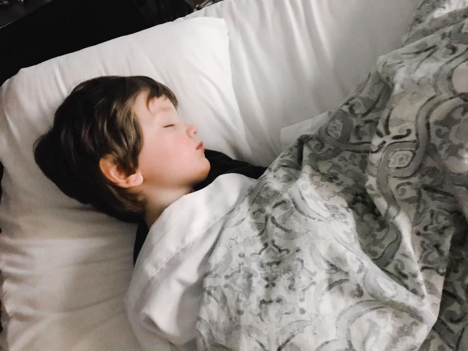 Little boy asleep on pillow
