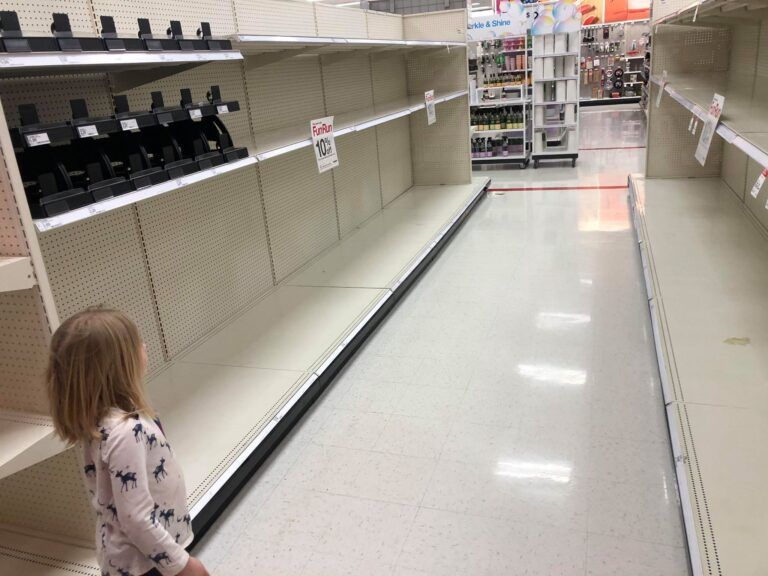 Girl standing in empty Target aisle