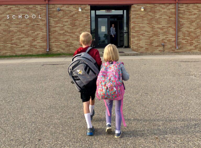 Kids walking into school building