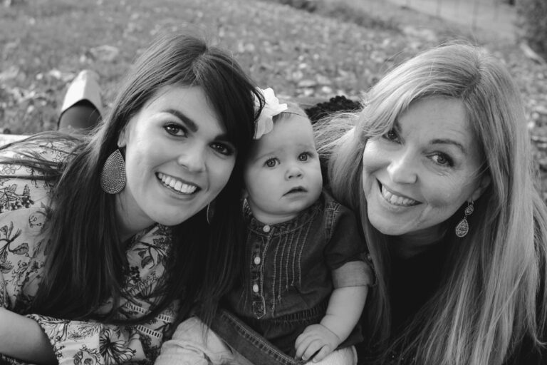 Grandmother, mother, and baby girl, black-and-white photo