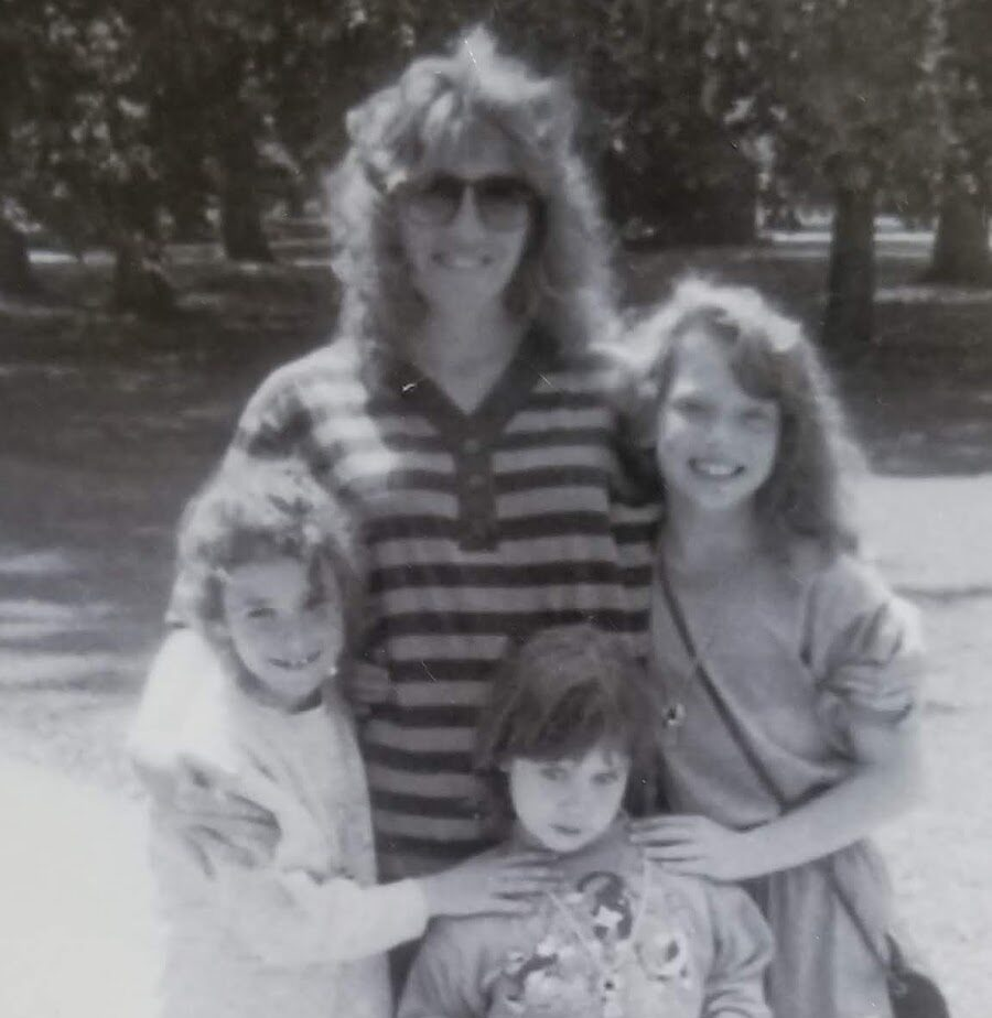 Mother with three children, black-and-white photo