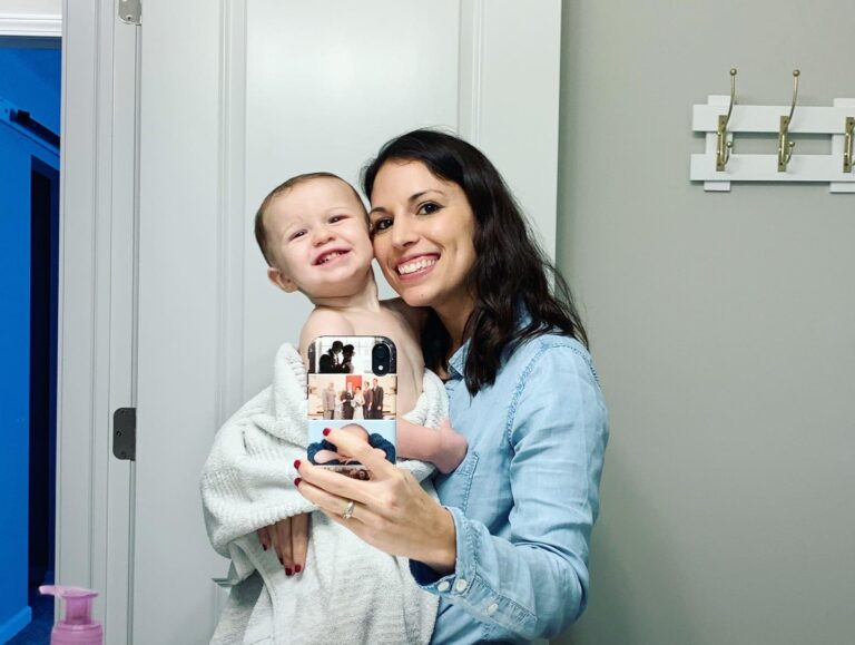 Mom holding son in a bath towel, selfie, color photo