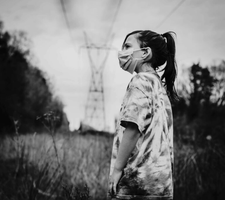 Little girl in face mask black and white photo