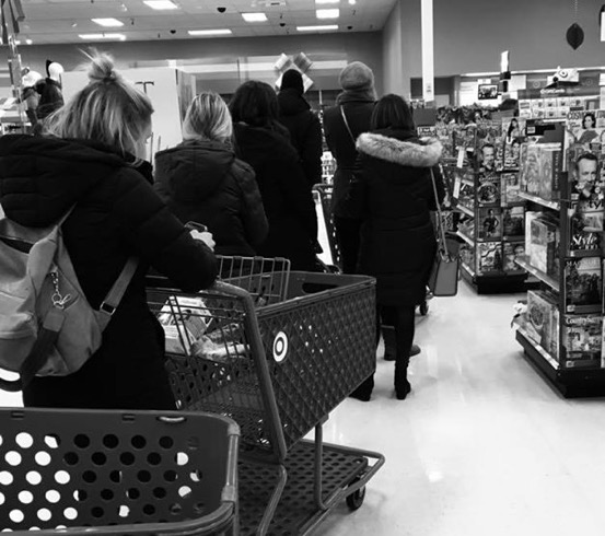 Black and white photo people shopping