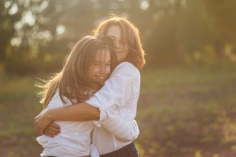 Woman hugging young girl