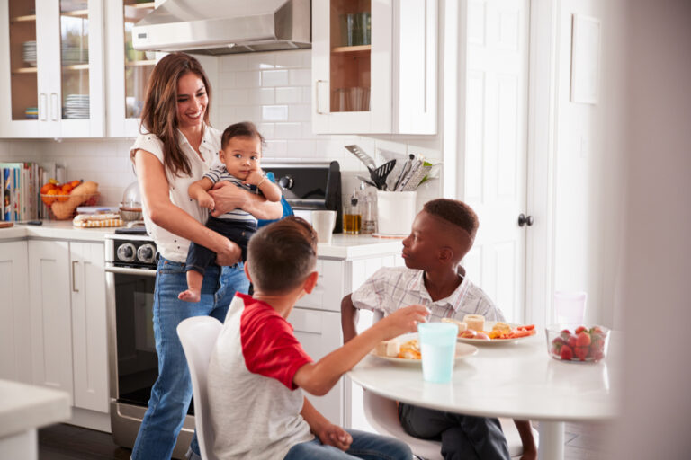 Mother at home in kitchen with kids