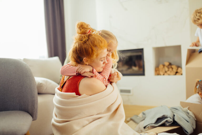 Mom with kids at home in living room