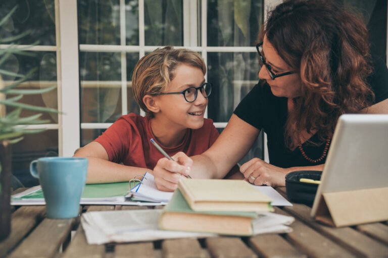 Mom teaching young boy homeschool